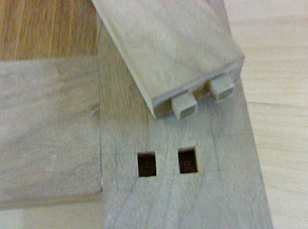 The bottom rail at the front of the cabinet has a double stub tenon. The rear rail is just a single stub tenon.