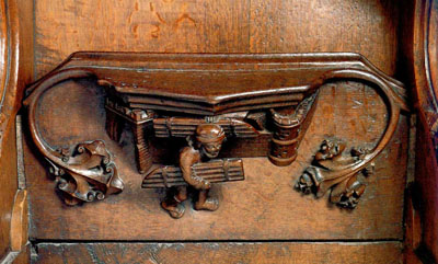 'In this Ripon Cathedral misericord (1489-94)Samson is shown passing in front of the crenellated walls of Gaza as he carries off the pair of city gates, one gate under his arm, the other over his shoulder (referring to the episode in Judges 16).'