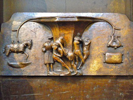 Wrestlers misericord at St Laurence, Ludlow, Shropshire, England.