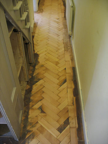 Into the hall and negotiating the narrow space with a large sanding machine is about as much fun as you might imagine.